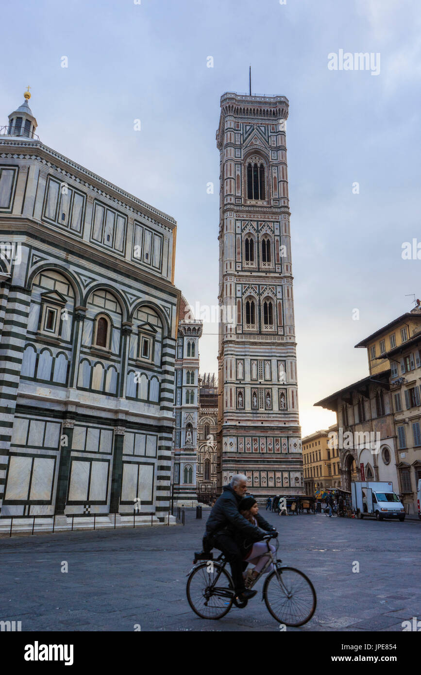 Florence, Tuscany, Italy.  The Duomo Square at sunrise with cyclist. - Stock Image