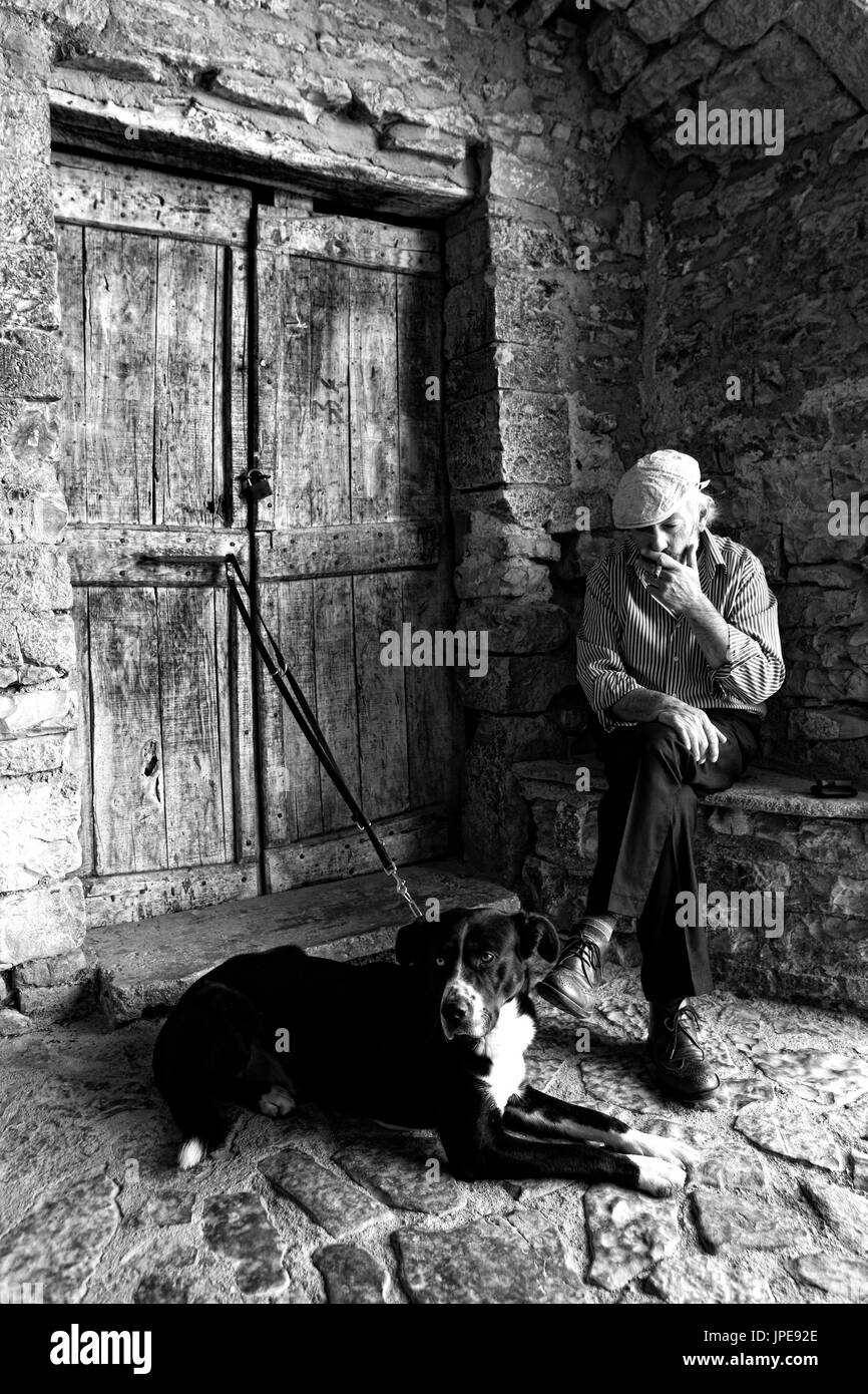 Europe, Italy,Umbria, Perugia district,Collepino Man's best friend - Stock Image
