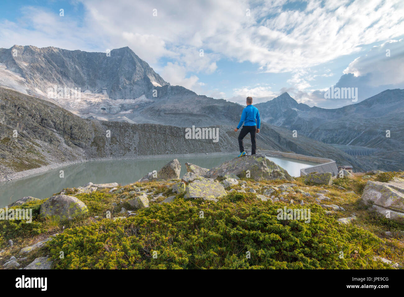 Hicker admire the Adamello Mount. Temù, Val d'Avio (Adamello Park), Brescia province, Lombardy, Italy, Europe Stock Photo