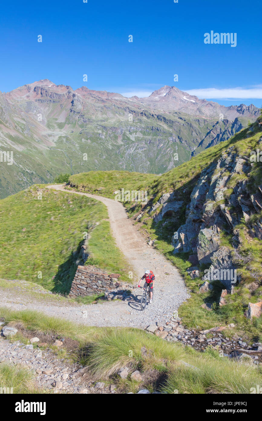 Mountain bike in the green valley framed by rocky peaks Val Di Viso ...