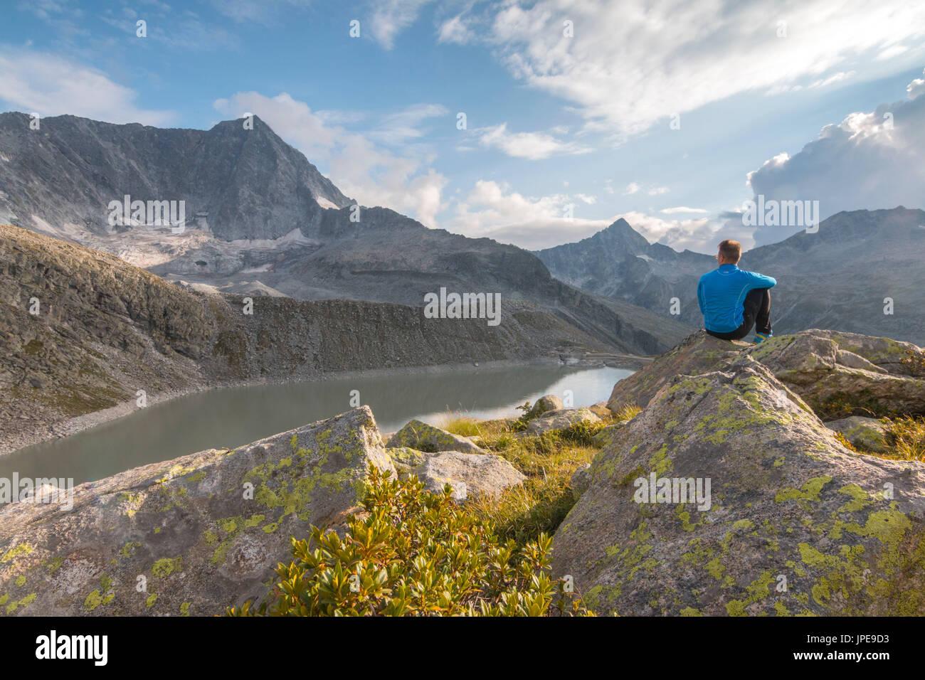 Hicker admire the Adamello Mount. Temù, Val d'Avio (Adamello Park), Brescia province, Lombardy, Italy, Europe - Stock Image