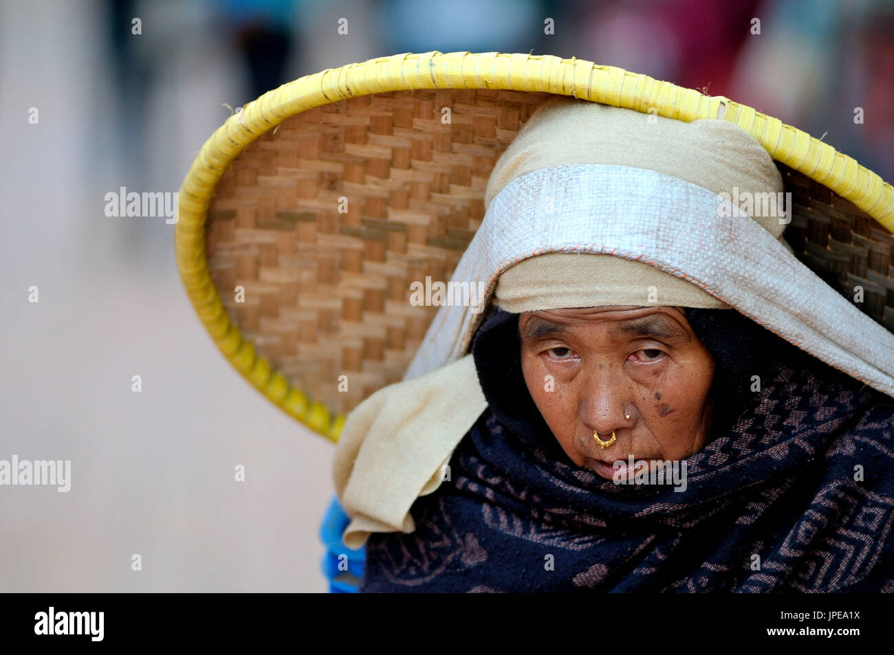 The best way to deliver the goods in Nepal, are the legs and an immense force on the back and head. This woman was carrying his goods to the center of Bhaktapur. - Stock Image