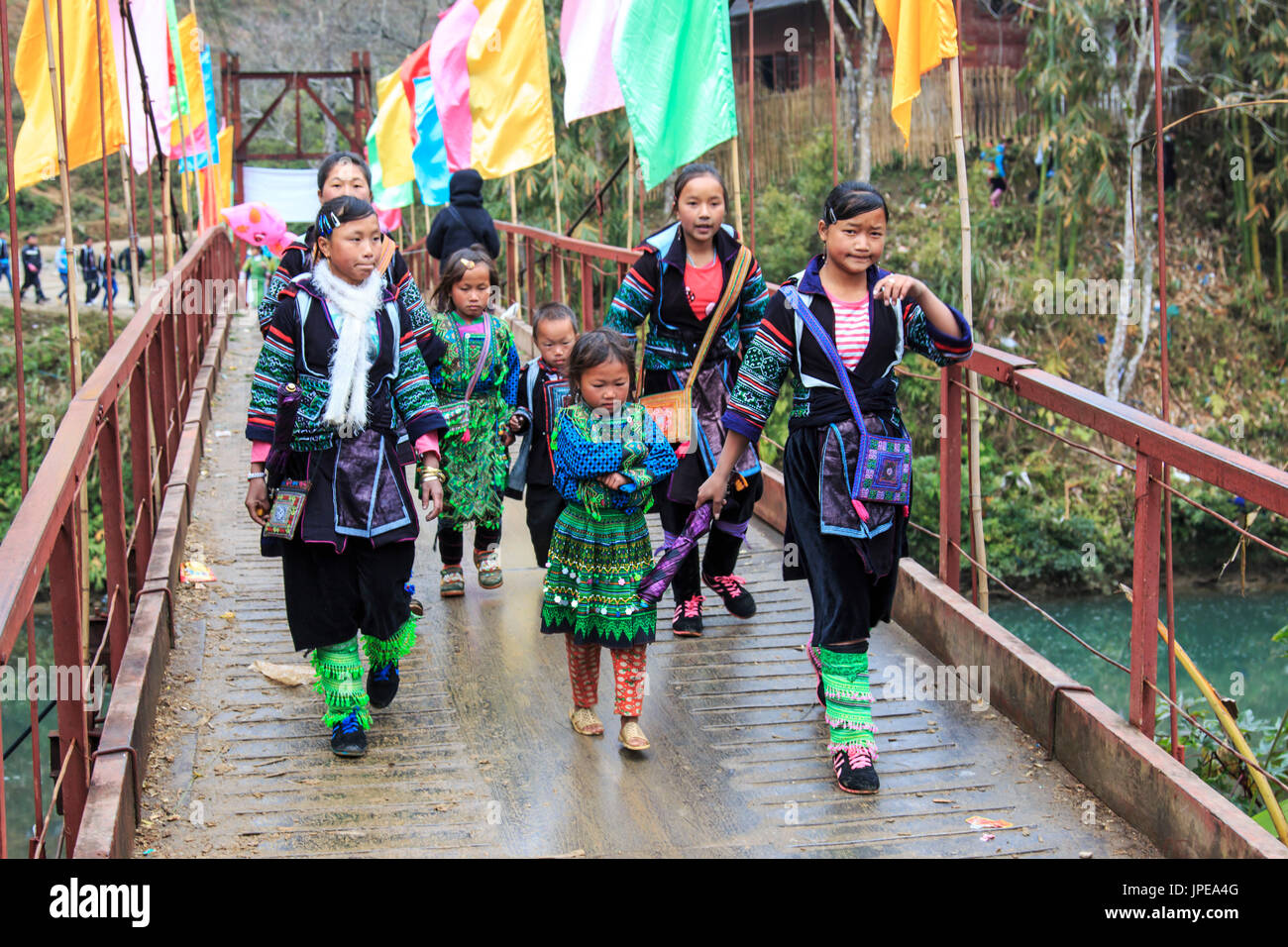 Aboriginal people of the mountains of Sapa, in north Vietnam, dressed with their traditional attire and walking in their village - Stock Image