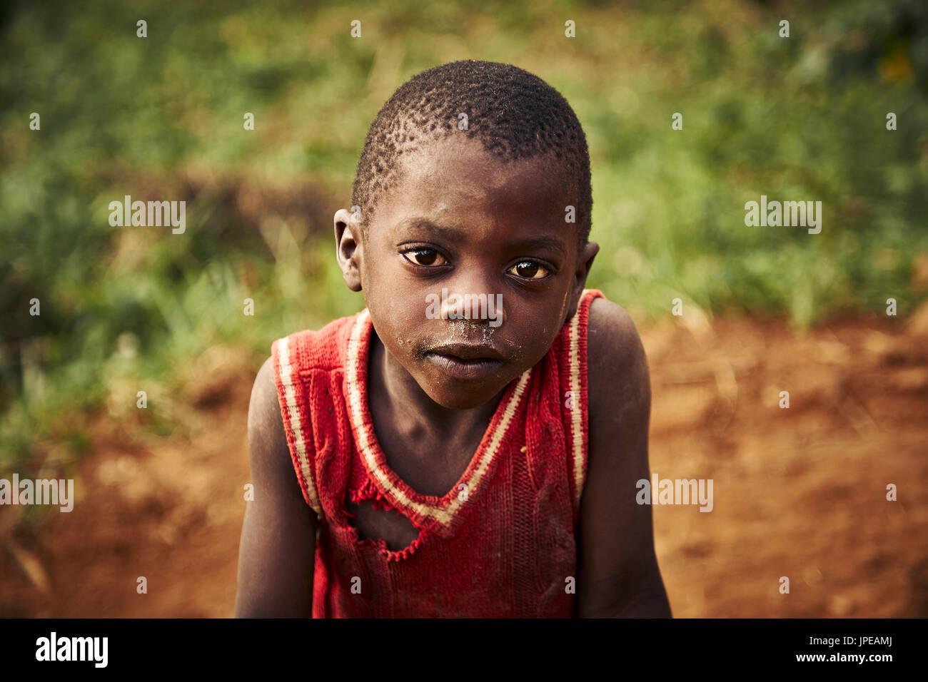 Poor kid in a tribal village near Bwindi Impenetrable Forest,Bwindi Impenetrable Forest, Bwindi National Park, Kanungu District, Kigezi sub-region, Uganda, Eastern Equatorial Africa, Africa - Stock Image