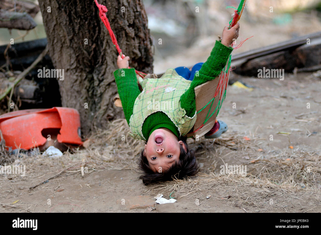 A Nepali child playing. Nepal - Stock Image