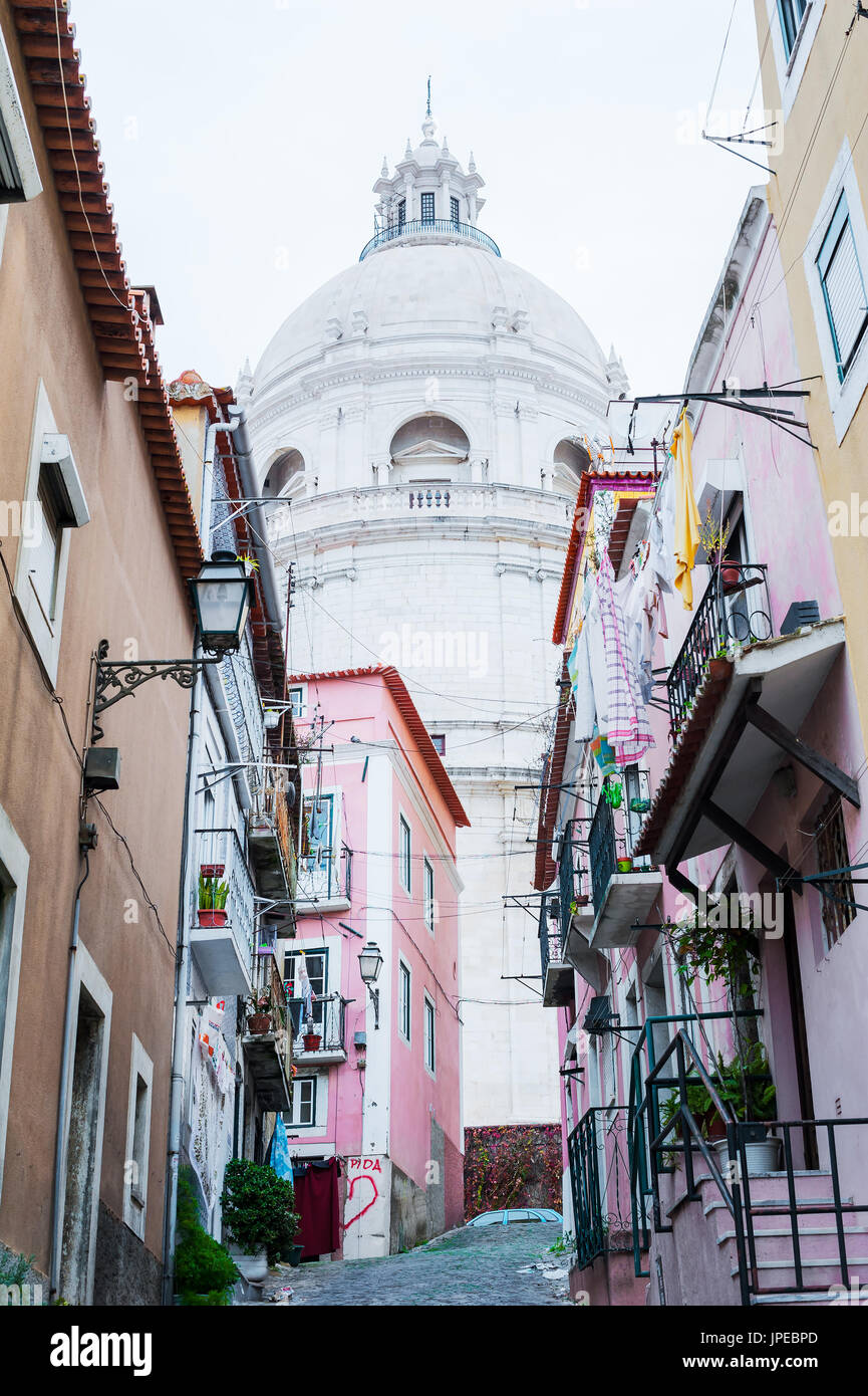Narrow street in Lisbon with the Pantheon in the background - Stock Image