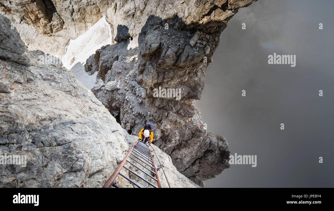 a view of the breathless ladder on the via ferrata 'bocchette alte' in the Brenta group, Trento province, Trentino Alto Adige, Italy, Europe - Stock Image