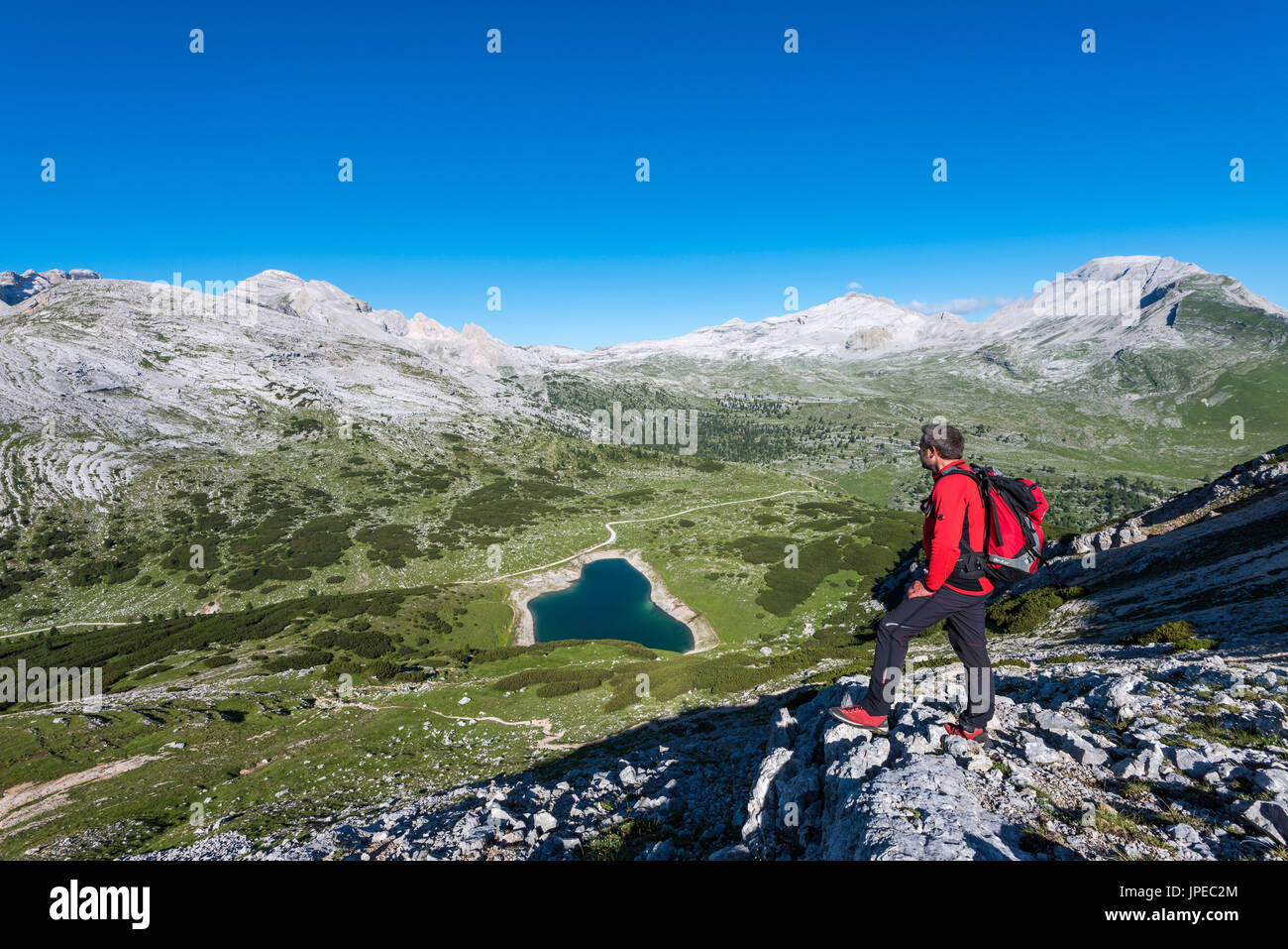 Fanes, Dolomites, South Tyrol, Italy. The refuge Lavarella. Hiker ascend to the Col Becchei - Stock Image