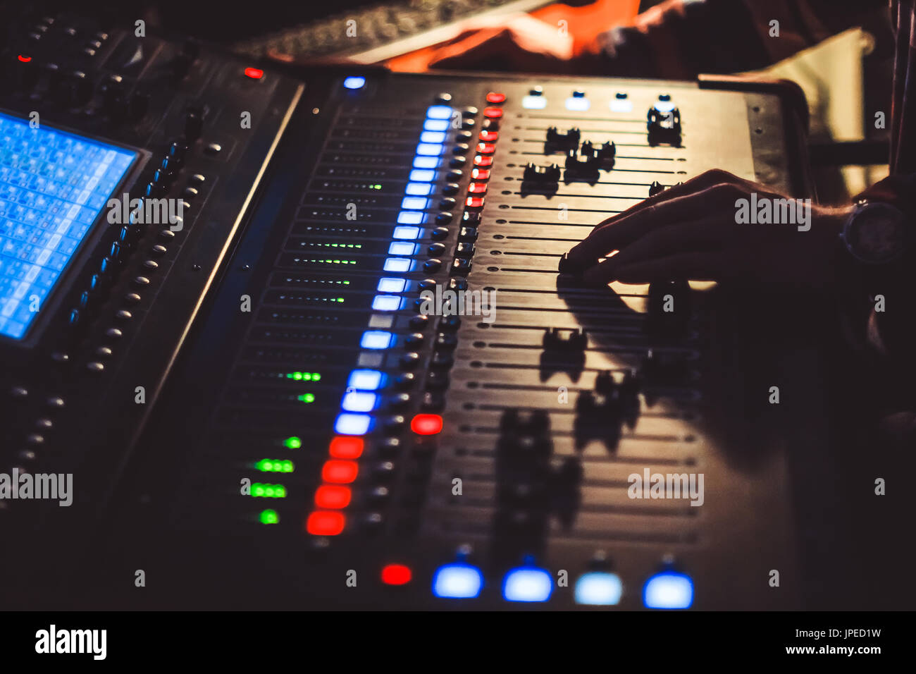 The hands of the sound engineer on the mixing console Stock Photo