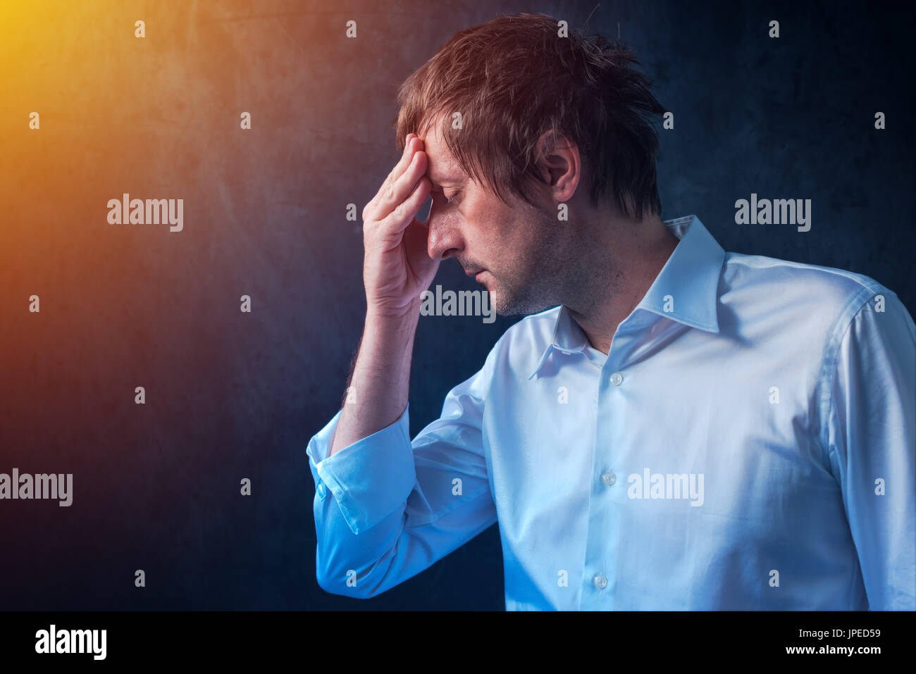 Businessman with hangover headache in the morning Stock Photo