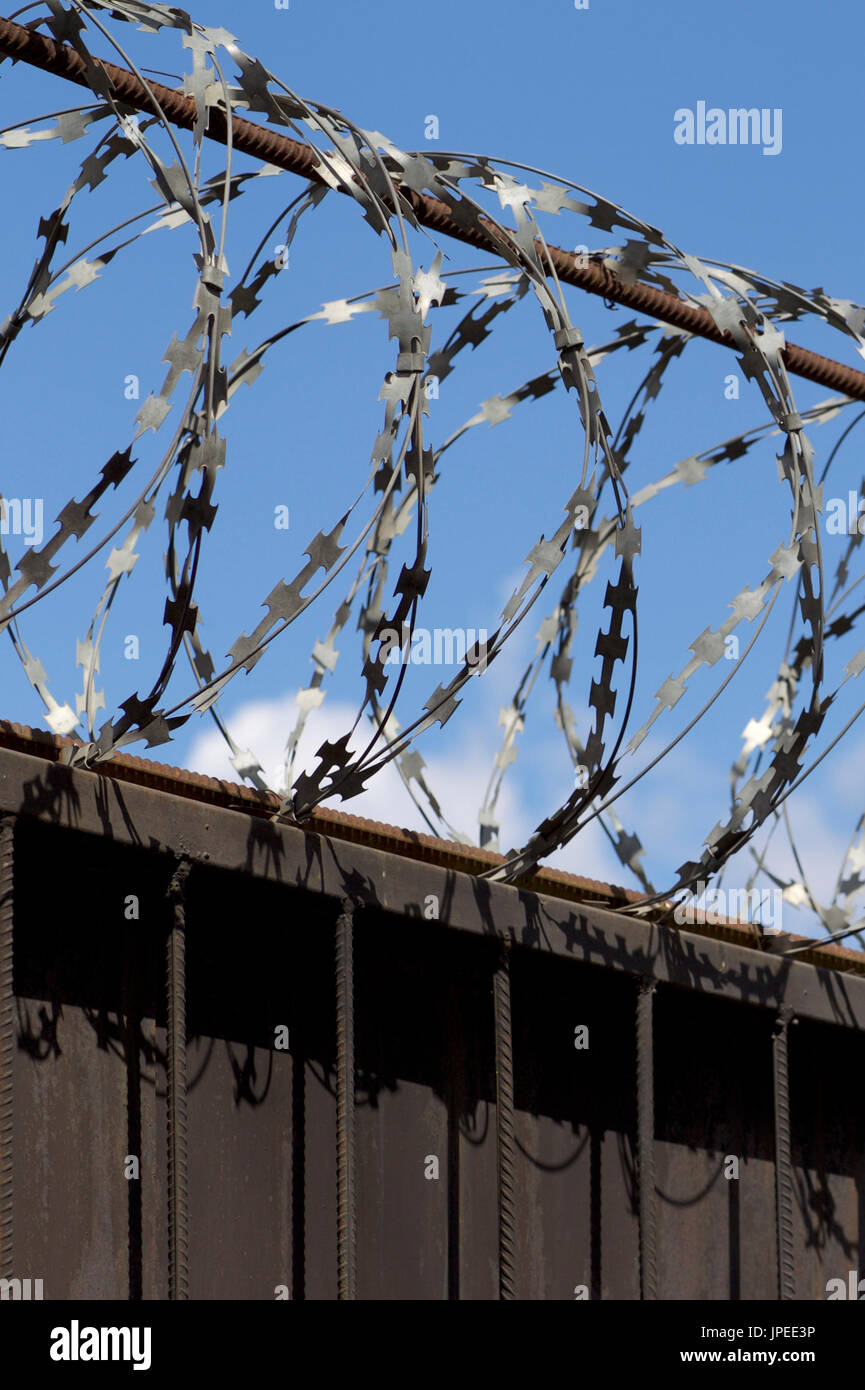 Barbed wire wound to the top of a fence, Russia Stock Photo ...