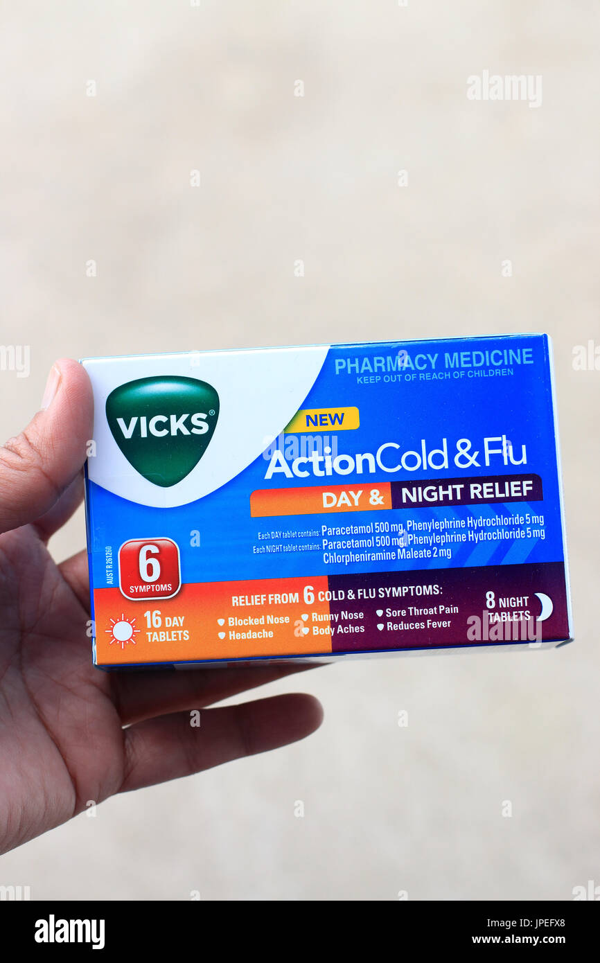 Vicks Action Cold and Flu Day and Night Relief  Vicks Action Cold and Flu Day and Night Relief tablets - Stock Image