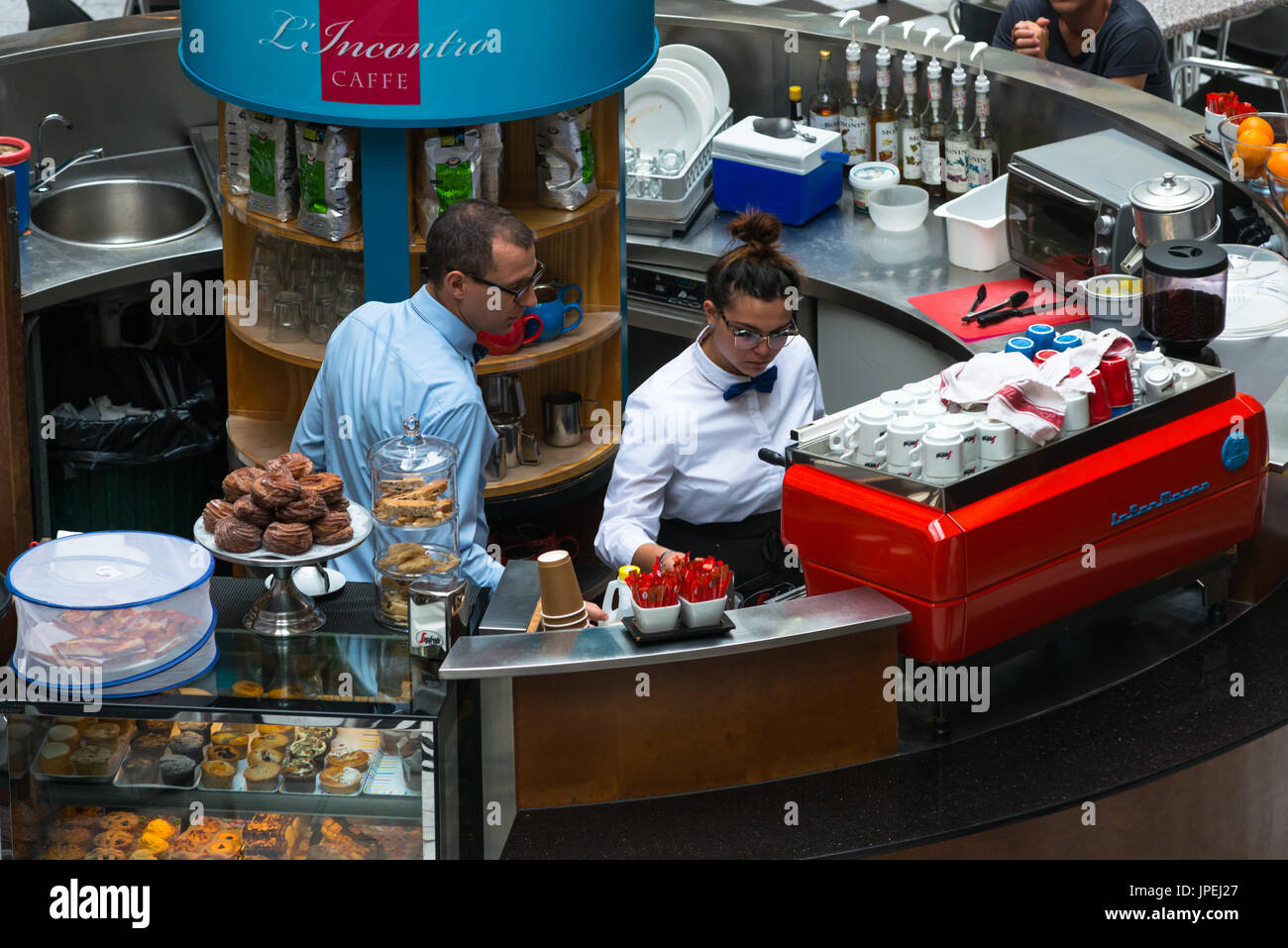 Waiters at cafe in Adelaide Arcade, Rundle Street Mall, Adelaide, South Australia. - Stock Image