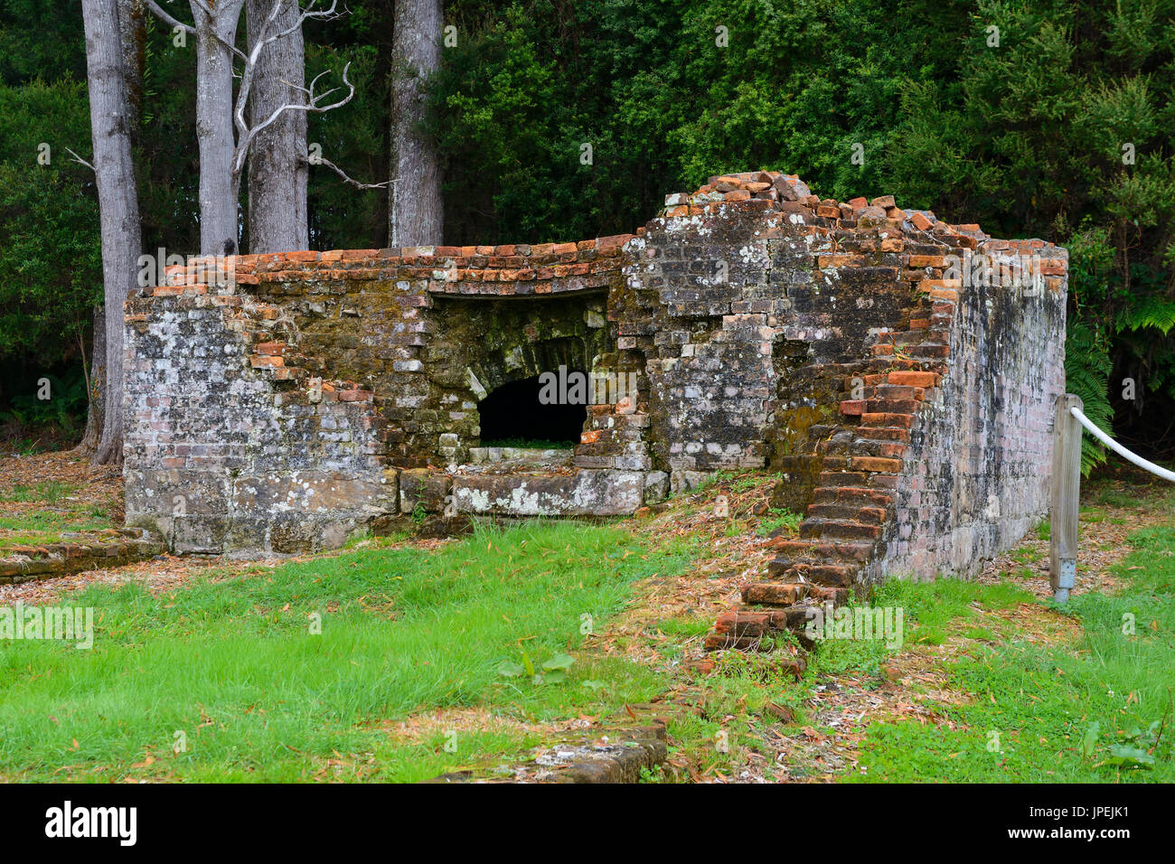Ruins of Bakehouse at Sarah Island historic site (former convict settlement) on Macquarie Harbour near Strahan in western Tasmania, Australia - Stock Image
