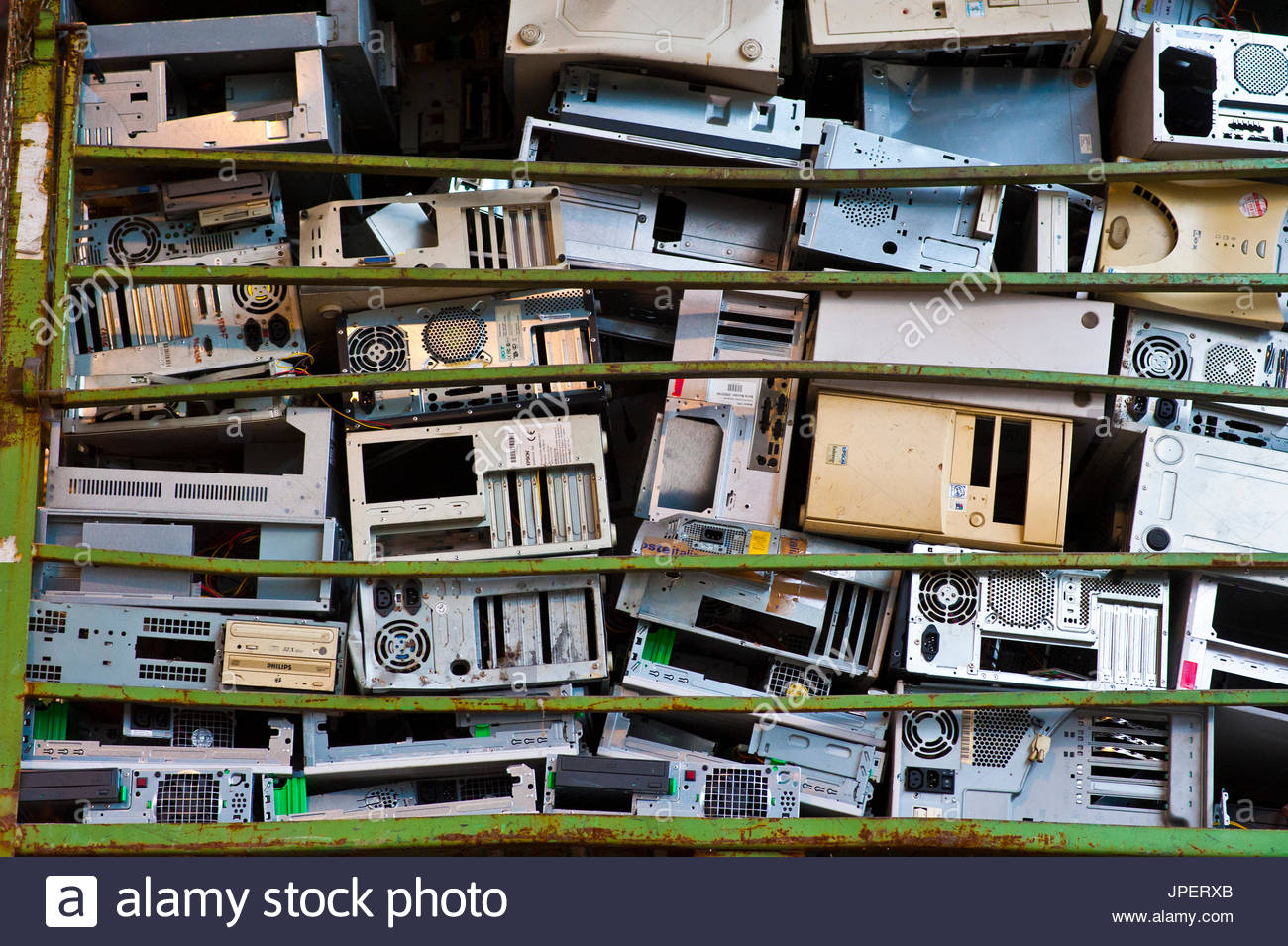 container full of old computer case in recycling plant - Stock Image