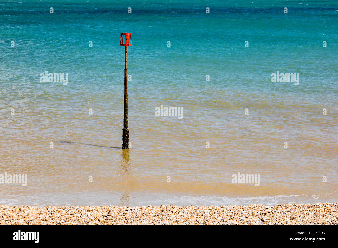 A navigation mark on the seafront at Deal, Kent, Uk against the Azure blue English Channel. Stock Photo