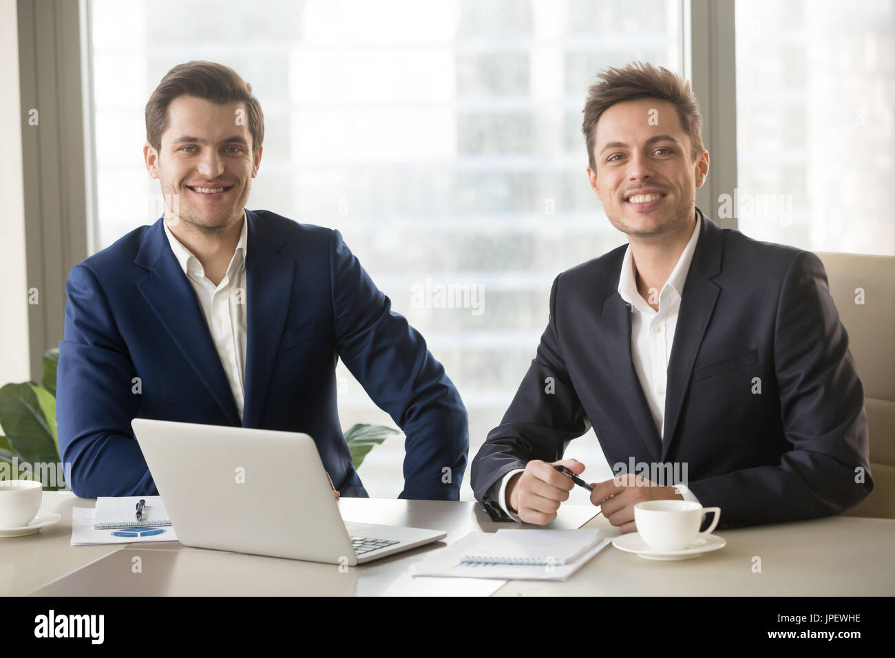 Two businessmen, financial analysts or investment advisers looki - Stock Image