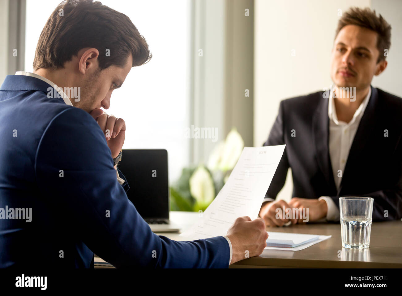 Skilled successful human resource manager analyzing resume at jo - Stock Image