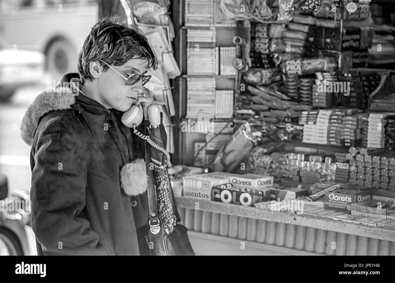 A woman on the telephone at a street kiosk in Athens in 1986 - Stock Image