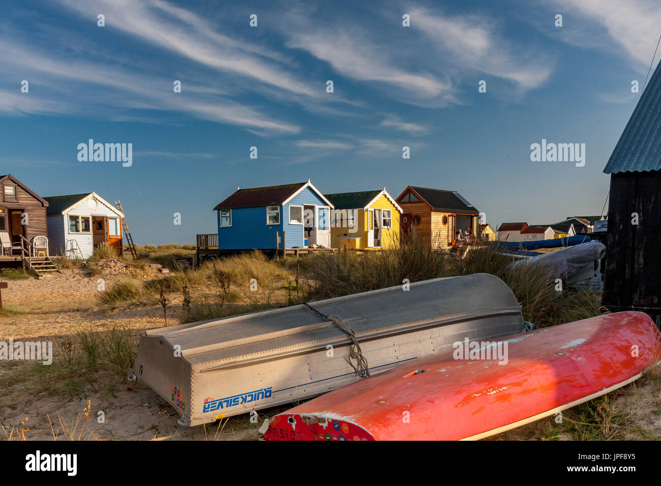 Highly desirable seaside wooden beach huts at Mudeford , Dorset .These highly desirable wooden beach huts are a quintessentially  British tradition . - Stock Image