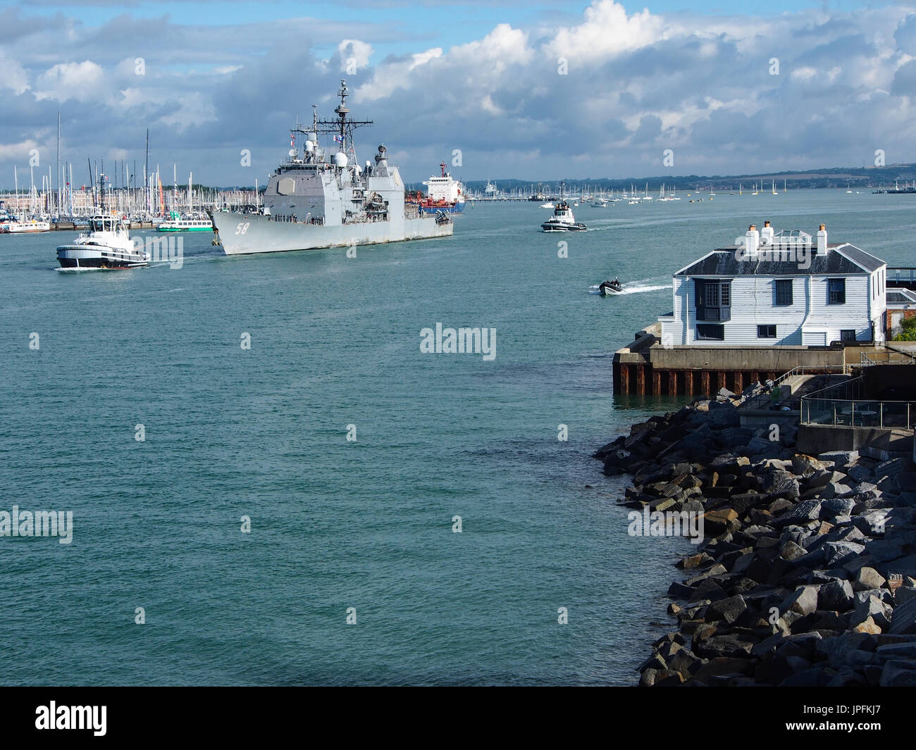 Portsmouth, Hampshire, UK. 01st Aug, 2017. The USS Philippine Sea, CG-58, a Flight II Ticonderoga-class guided missile cruiser, leaves Portsmouth Harbour after a week long visit along with other ships involved in Operation Inherent Resolve, the Global Coalition's fight against ISIS. Other members of the task group included USS Donald Cook, Norwegian ship HNoMS Helge Insgstad and USS George H W Bush a Nimitz class, nuclear powered aircraft carrier. Credit: simon evans/Alamy Live News - Stock Image