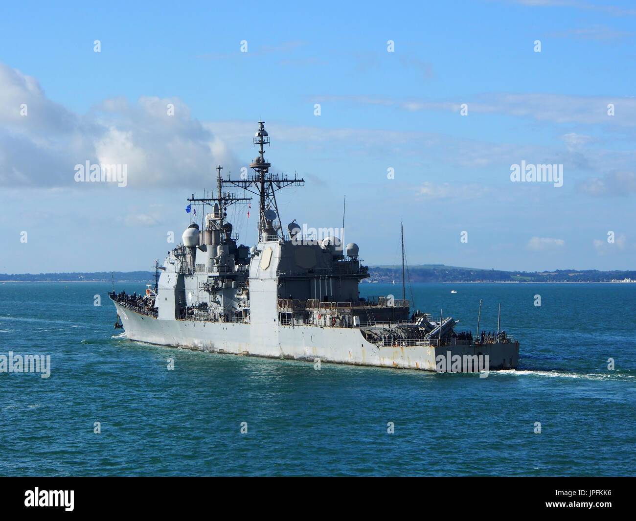 Portsmouth, Hampshire, UK. 01st Aug, 2017. The USS Philippine Sea, CG-58, a Flight II Ticonderoga-class guided missile cruiser, leaves Portsmouth Harbour after a week long visit along with other ships involved in Operation Inherent Resolve, the Global Coalition's fight against ISIS. Credit: simon evans/Alamy Live News - Stock Image