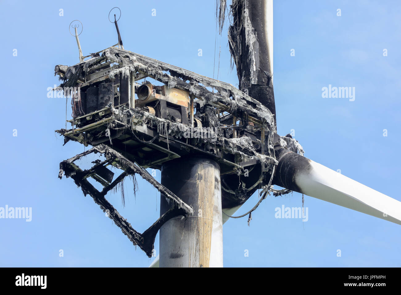 Kothen, Germany. 01st Aug, 2017. Picture of a burned wind turbine taken at a wind farm in Kothen, Germany, 01 August 2017. On Tuesday morning the fire department put off the falling, lit debris and allowed the turbine itself to burn out in a controlled manner. The cause of the fire is thought to be a strike of lightning (aerial shots taken with a drone). Photo: Jan Woitas/dpa-Zentralbild/ZB/dpa/Alamy Live News - Stock Image