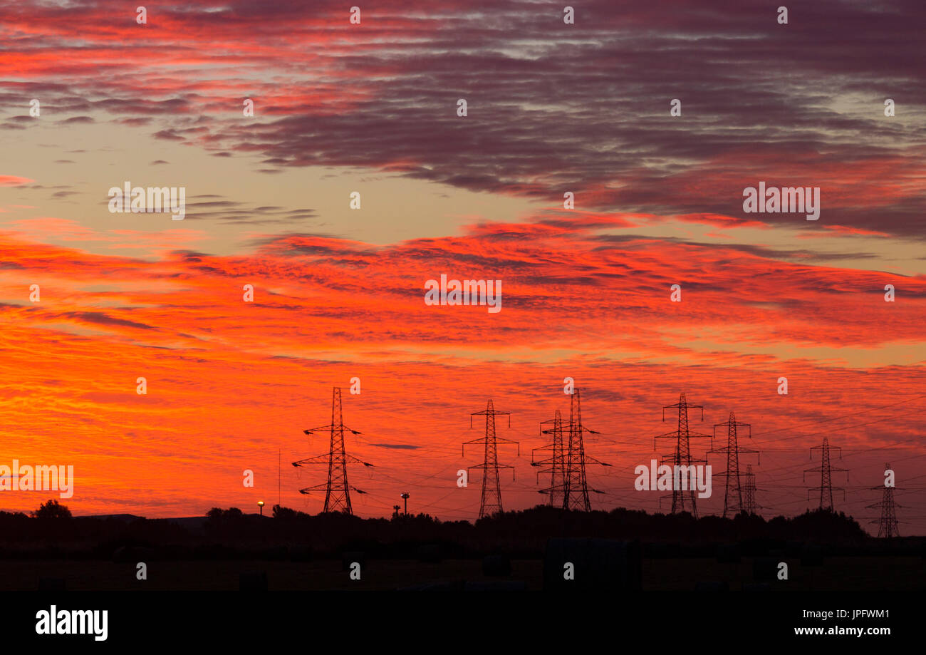 Billingham, north east England, UK, 2nd August, 2017. UK Weather: Shepherds warning sky. As a band of early morning rain sweeps across the south and west of the UK on Wednesday morning, it`s a glorious sunrise on the east coast, where the rain is not expected unitl mid afternoon. Credit: ALAN DAWSON/Alamy Live News - Stock Image