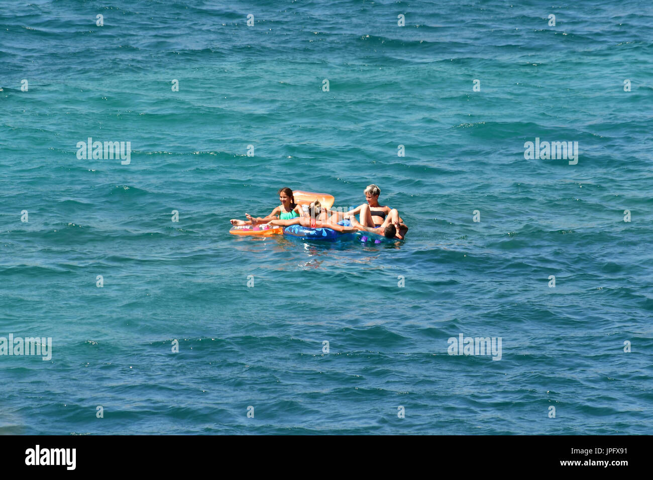 Nafplion, Greece. 02nd Aug, 2017. Greece, Nafplion, 2 August 2017. Tourists enjoy their swim in the beautiful Karathonas beach in the city of Nafplio, in the south-eastern Peloponnese. Credit: VANGELIS BOUGIOTIS/Alamy Live News - Stock Image