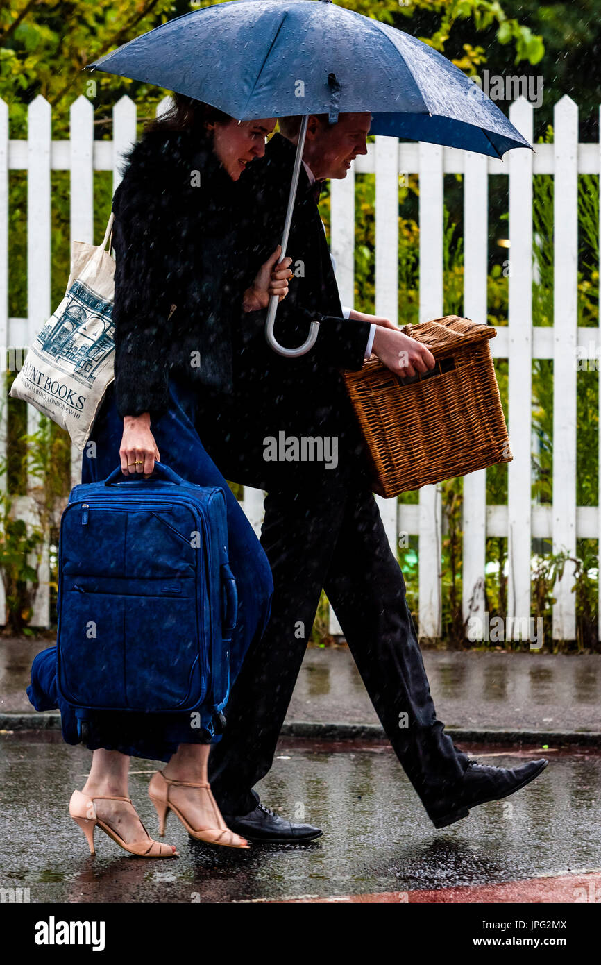 Lewes, UK. 2nd Aug, 2017. UK Weather. Young people arrive at Lewes train station in the rain en route to Glyndebourne Opera House for a performance of Don Pasquale, Lewes, East Sussex, UK. Credit: Grant Rooney/Alamy Live News - Stock Image
