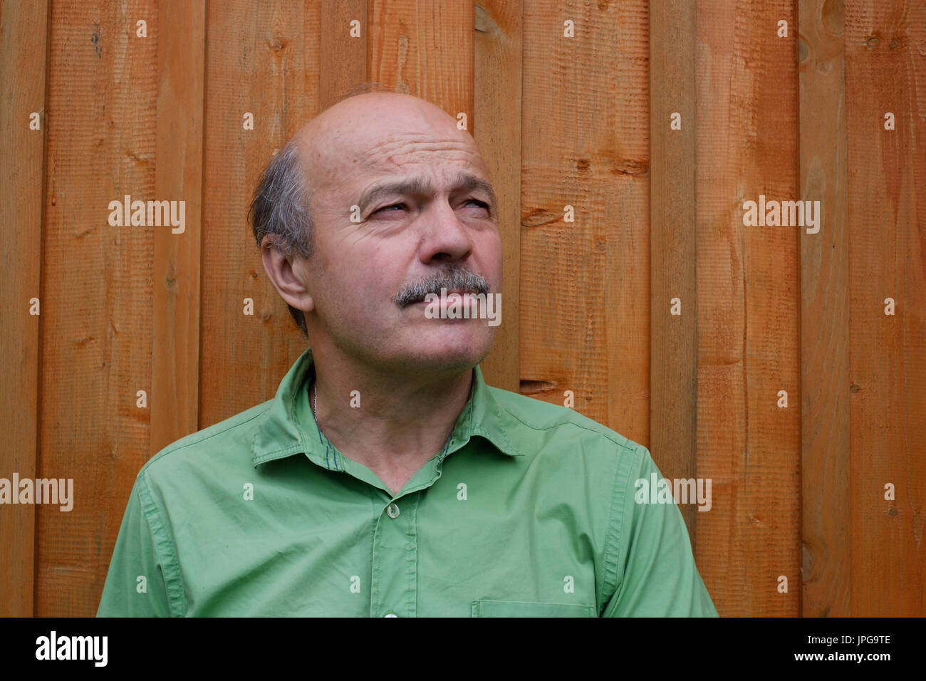 Caucassian man grimacing, portrait. - Stock Image