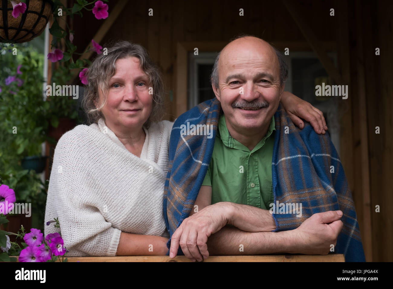 Cheerful senior couple enjoying life at countryside house - Stock Image
