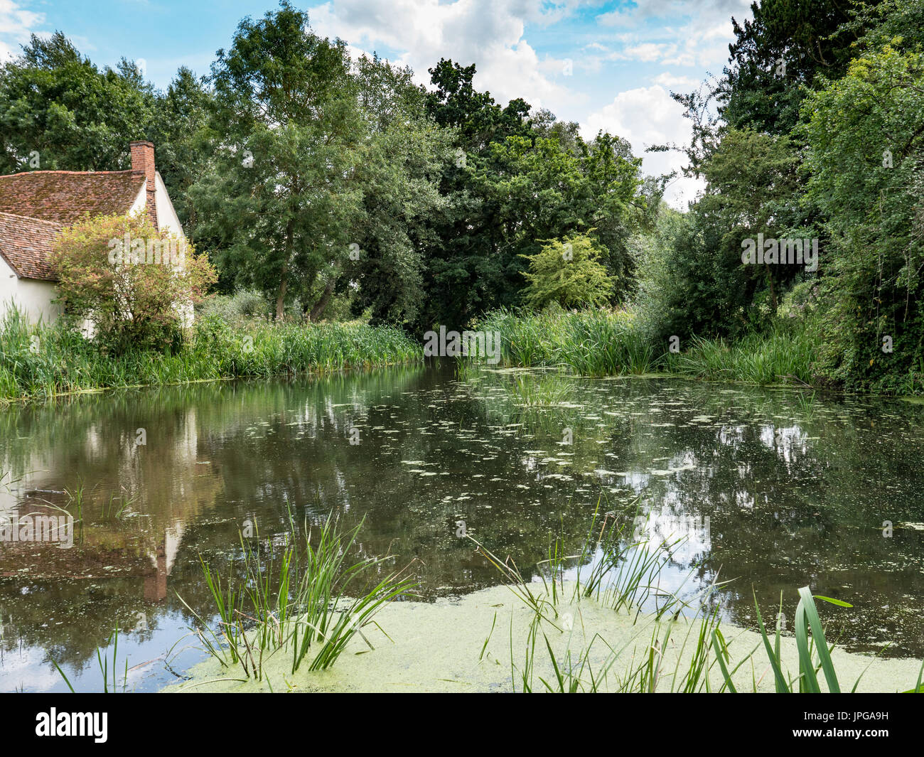Willy Lott's cottage at Flatford Mill, as seen in the painting The Hay Wain by the artist John Constable. Suffolk, Stock Photo