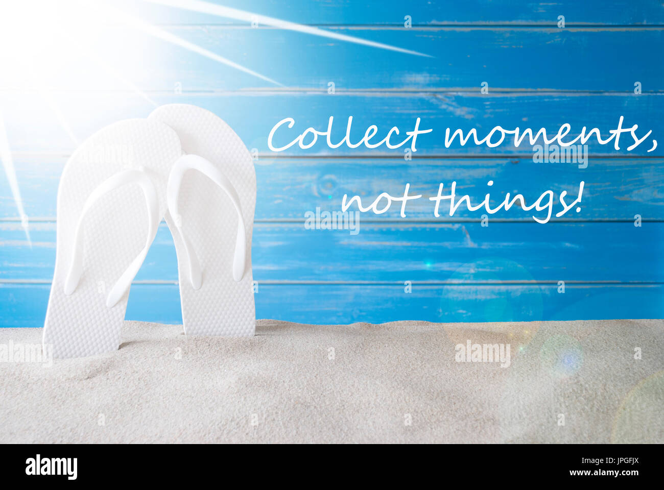 fa270e39b English Quote Collect Moments Not Things. Sunny Summer Greeting Card With  Sand And Flip Flops. Blue Vintage And Shabby Chic Wooden Background.