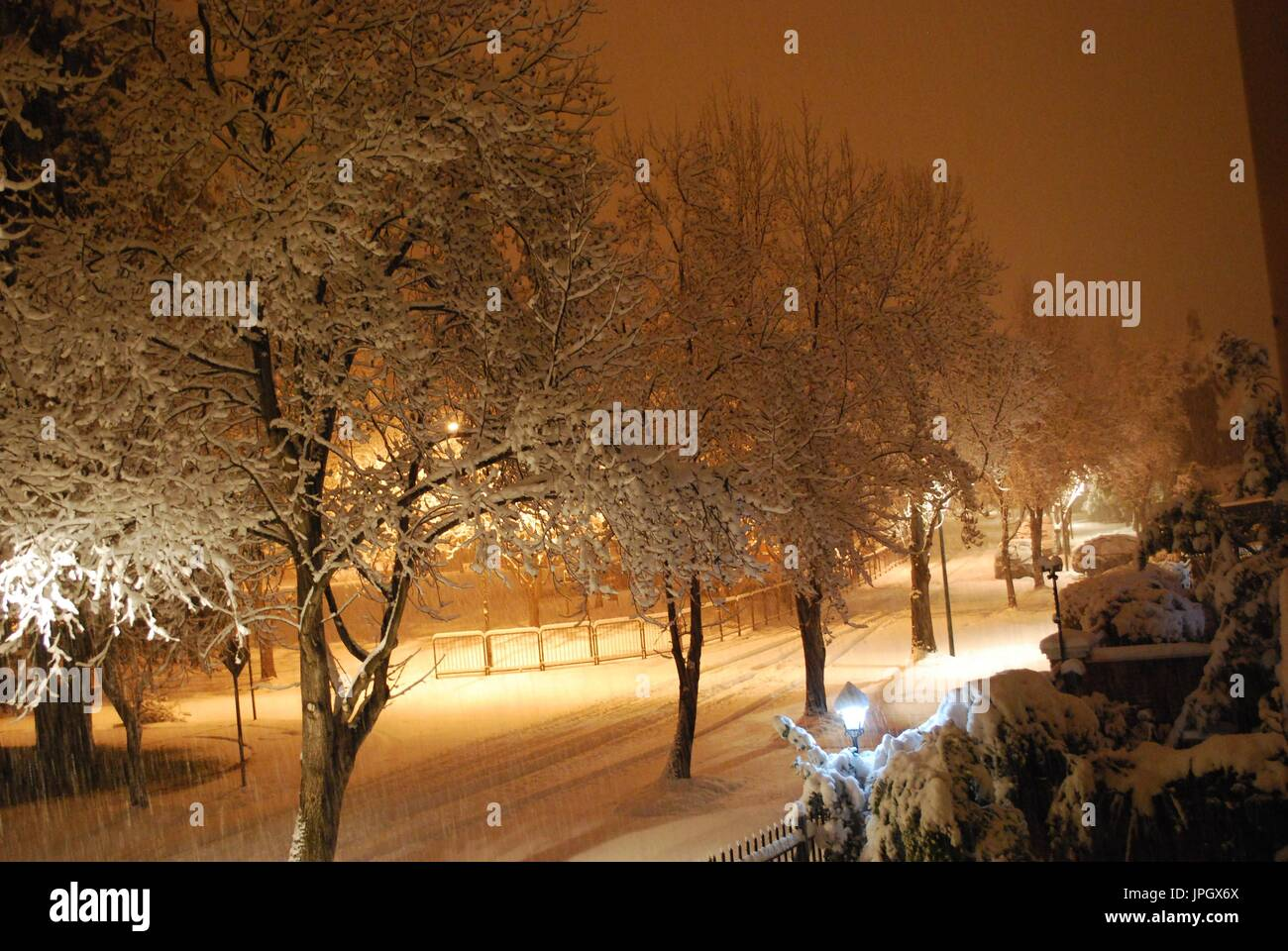 Snowing on the street at night - Stock Image