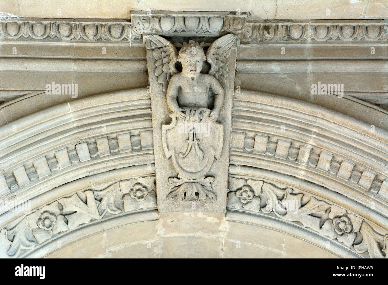 Sculpture of angel boy on on facade of architectural building in downtown Baku. - Stock Image