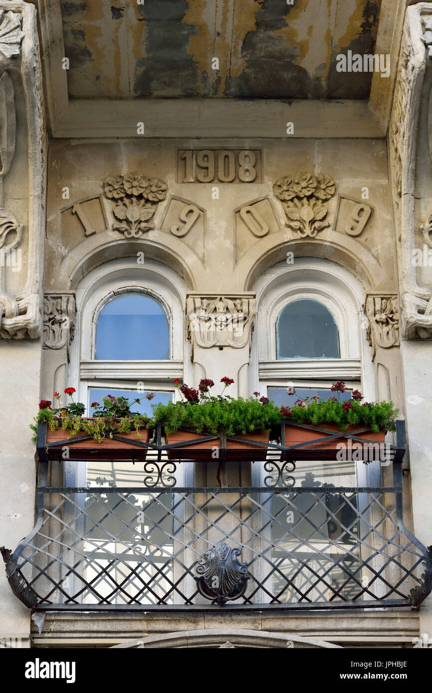 Balcony of architectural building in downtown Baku, with flowers and ornaments. - Stock Image