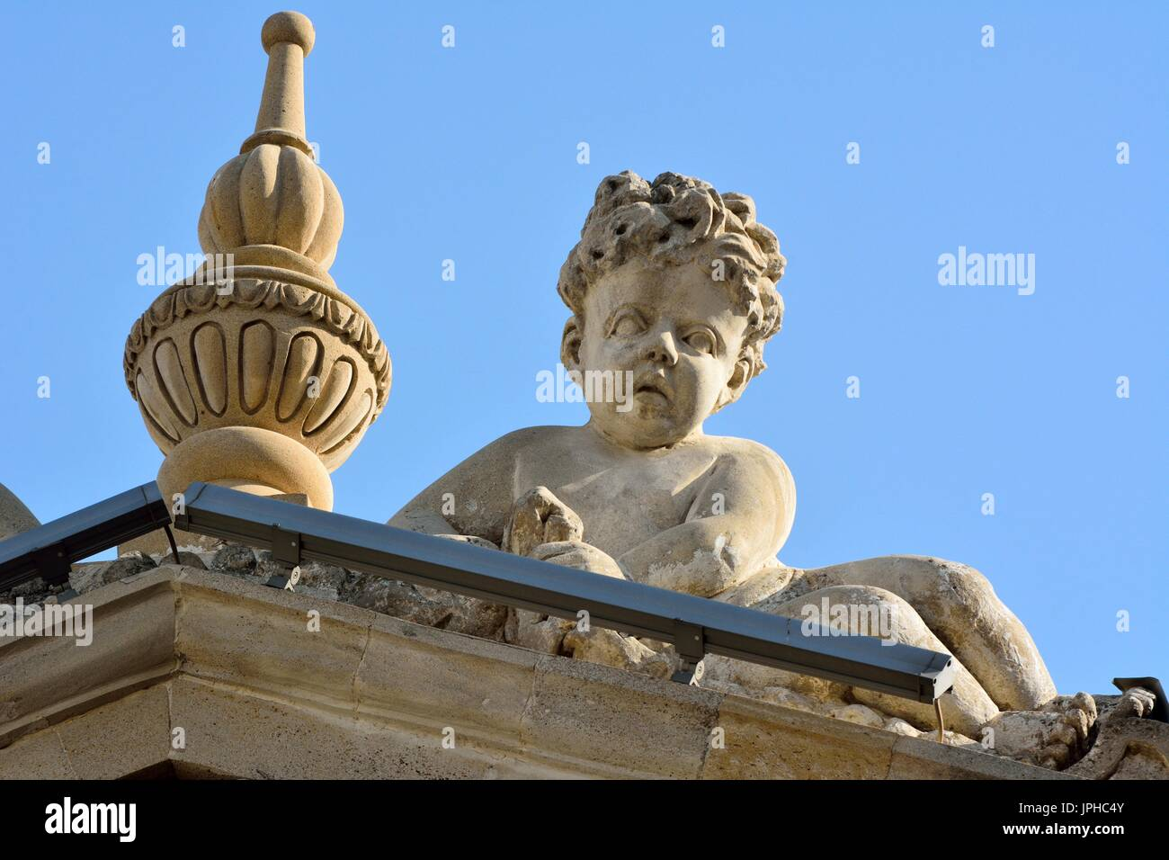 Sculpture of angel boy on facade of architectural building in downtown Baku. - Stock Image