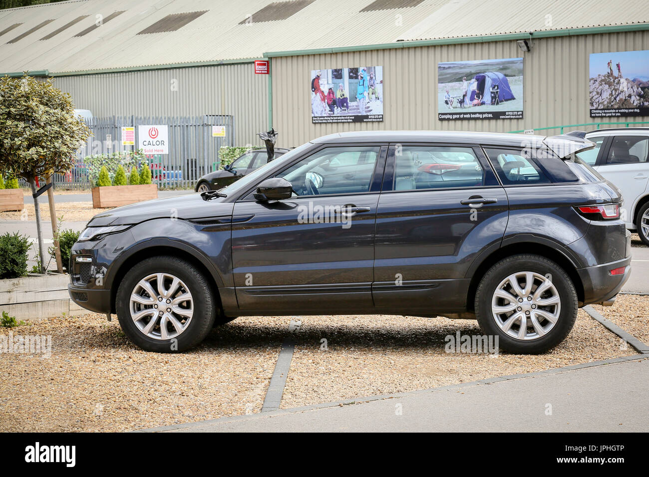 A badly parked 4x4 car - Stock Image