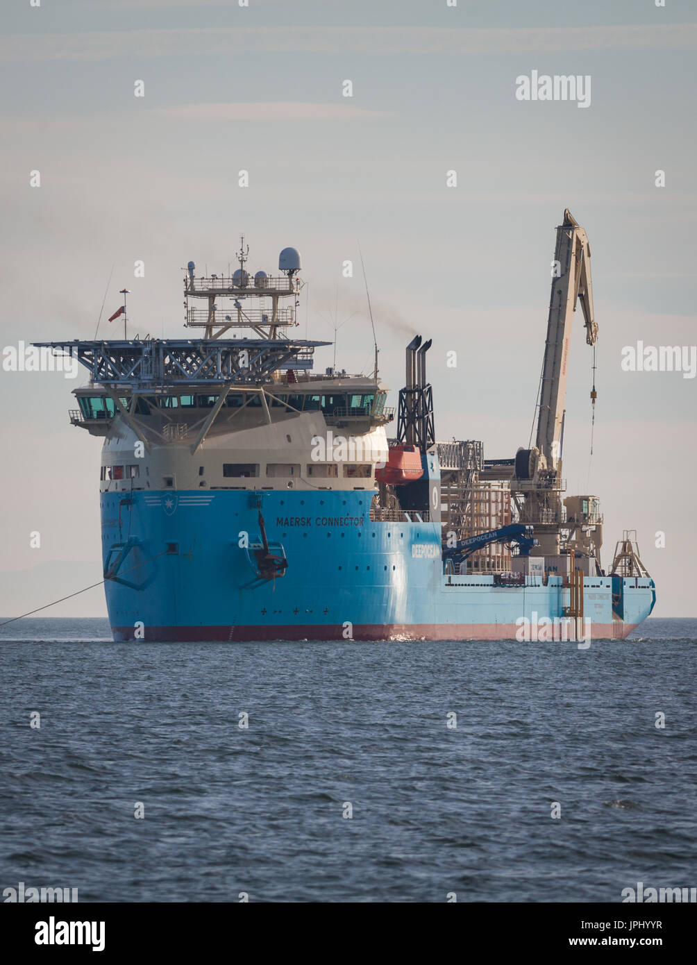 The cable lay vessel, Maersk Connector, installing the Walney 3 export cable. The wind farm will become part of the world's largest offshore wind farm, and is located off the coast of Cumbria, UK - Stock Image