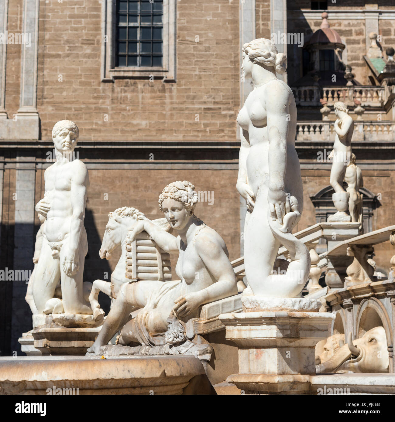 Marble statues of nymphs, humans, mermaids and satyrs on the 16th century Florentine fountain in Piazza Pretoria, central Palermo, Sicily, Italy. - Stock Image