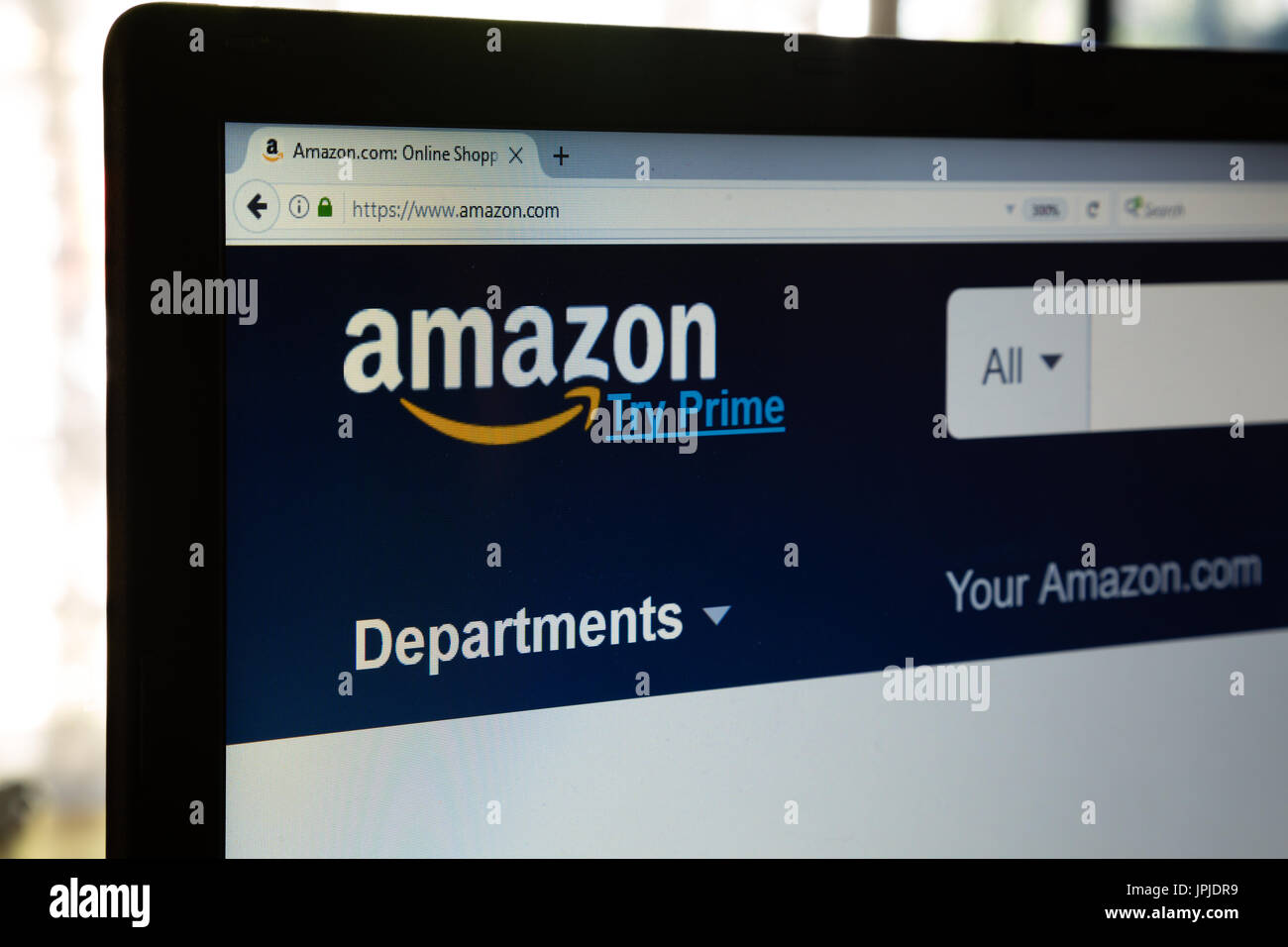 Amazon home page on a laptop computer screen - Stock Image