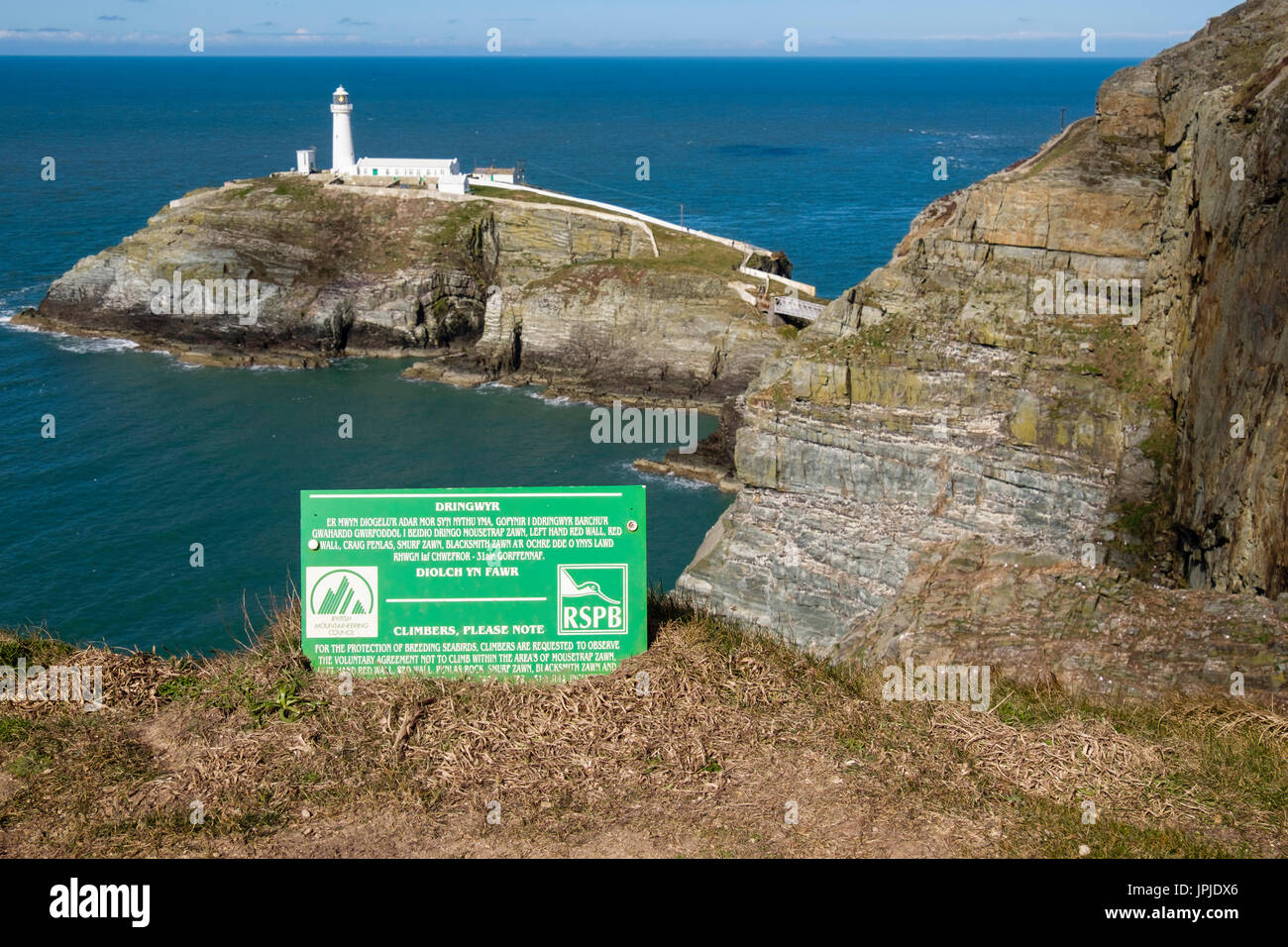 British Mountaineering Council and RSPB voluntary agreement notice to climbers about protecting nesting birds on sea cliffs at South Stack Anglesey UK - Stock Image