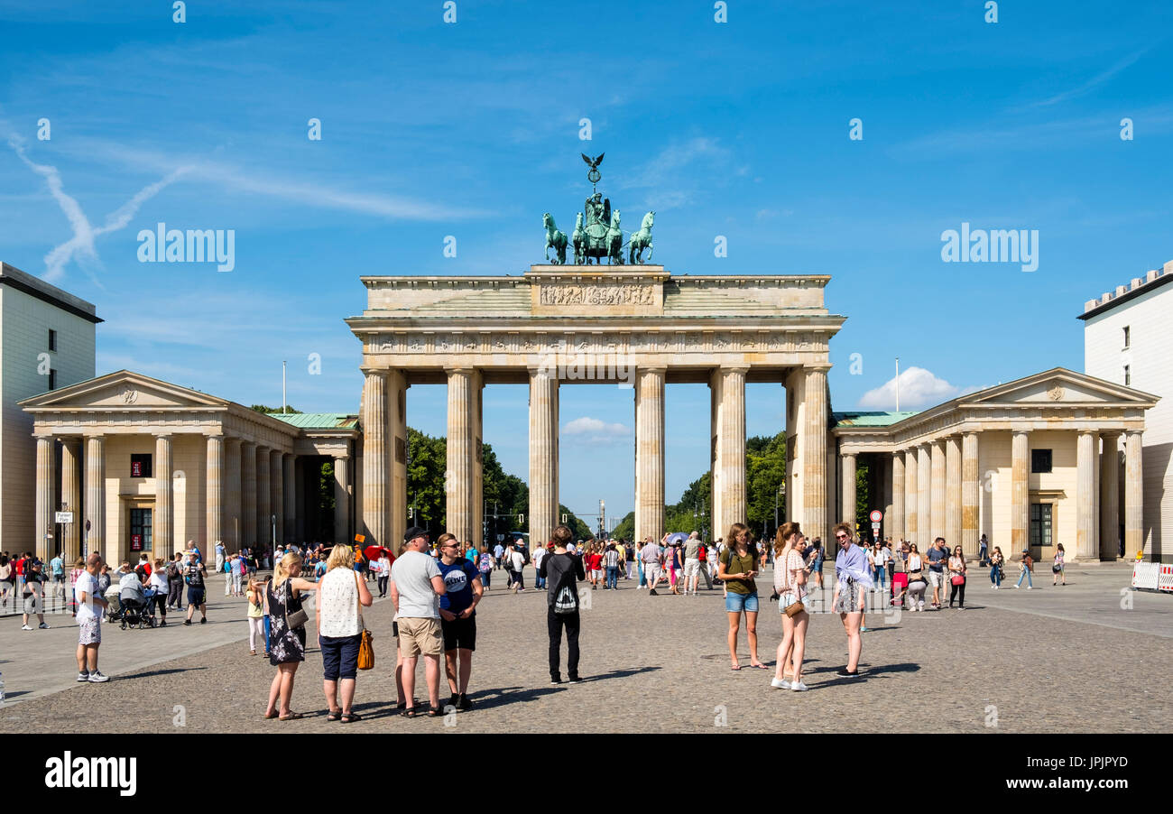Many tourists standing in front of Brandenburg Gate in Mitte district of Berlin Germany - Stock Image