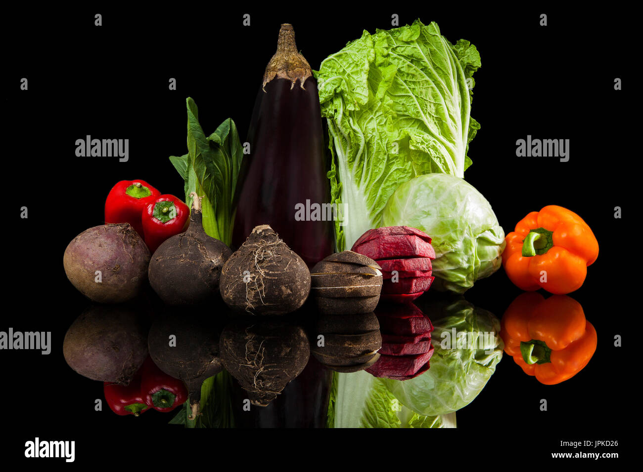 Luxurious colorful fresh vegetable isolated on black background. Beet, capsicum, cabbage, chinese cabbage, fennel, - Stock Image