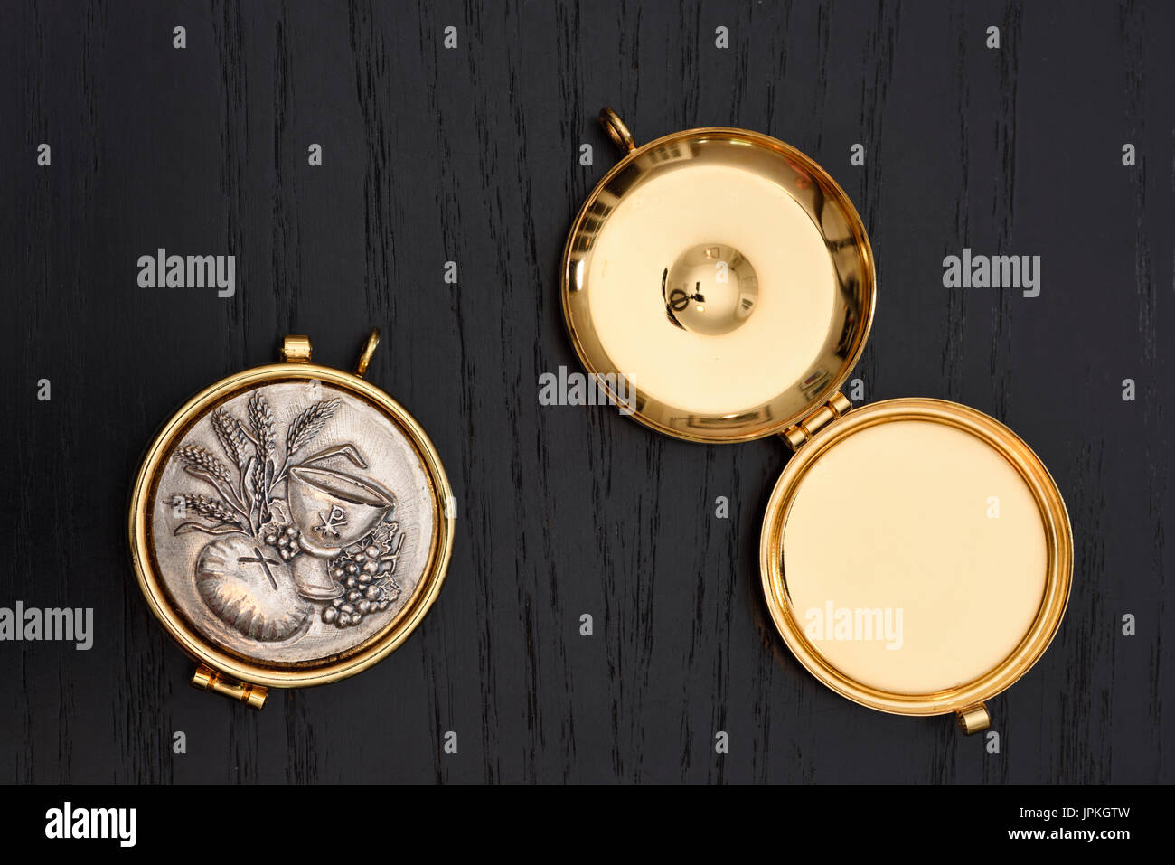 Gold Pyx to carry the consecrated eucharistic communion wafer host the holy body of Jesus Christ - Stock Image