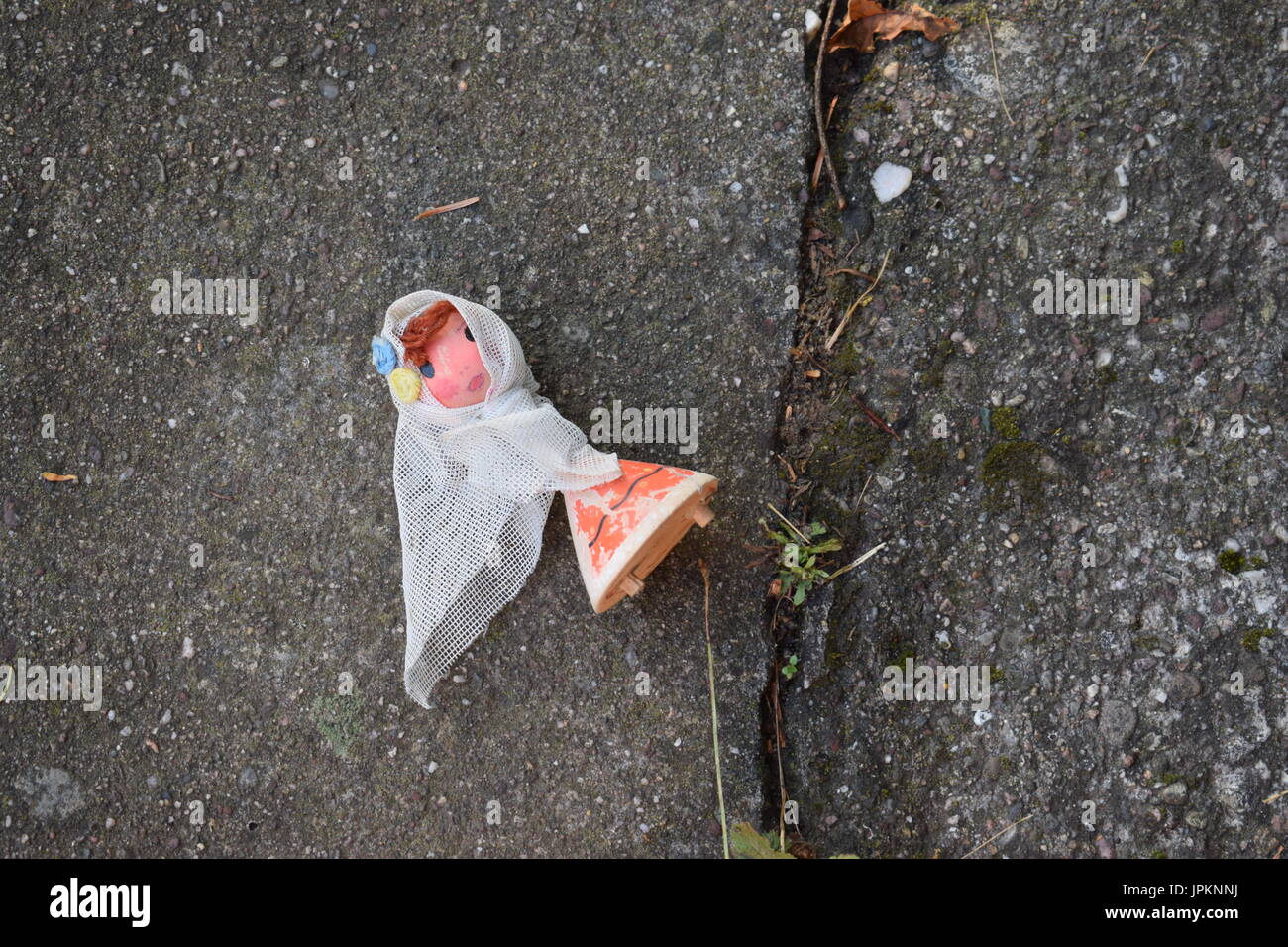 Old doll thrown away - Stock Image