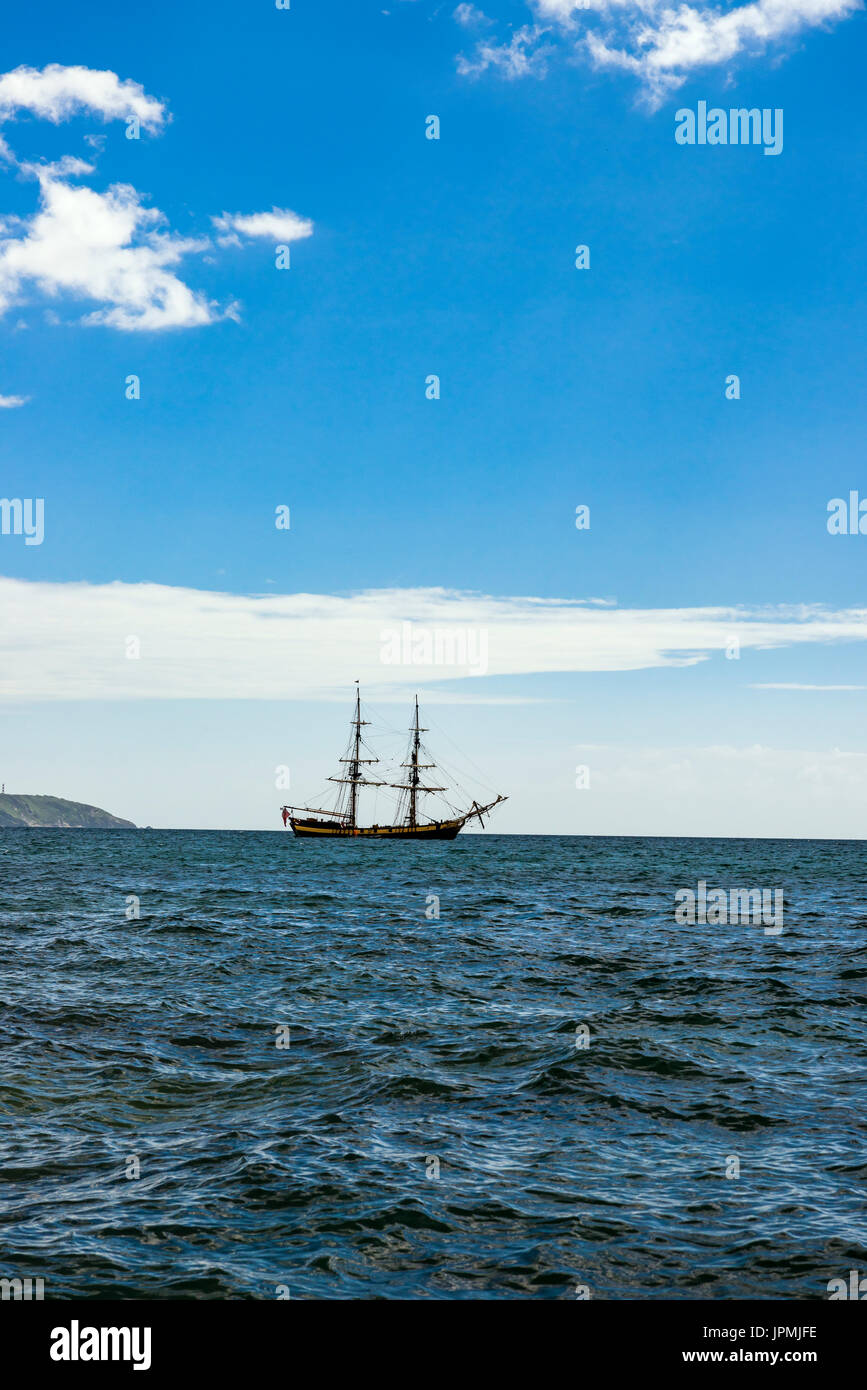 The Pheonix is a histoic Tall ship that is often moored in Charlestown harbour, but takes short trips around Cornwall to show off its formidable prowe - Stock Image