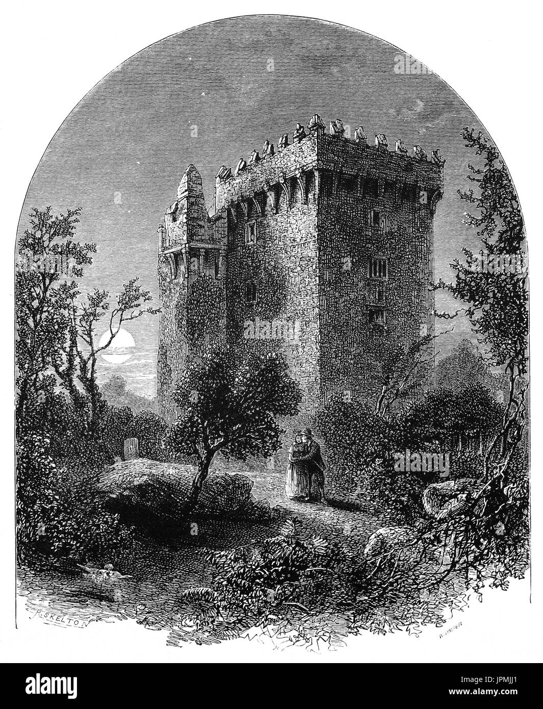 1870: Blarney Castle, a medieval stronghold in Blarney. The current keep was built by the MacCarthy of Muskerry dynasty, a cadet branch of the Kings of Desmond, and dates from 1446. The Blarney Stone where tourists visiting the castle may hang upside-down over a sheer drop to kiss the stone, which is said to give the gift of eloquence. is among the machicolations of the castle. County Cork, Ireland - Stock Image