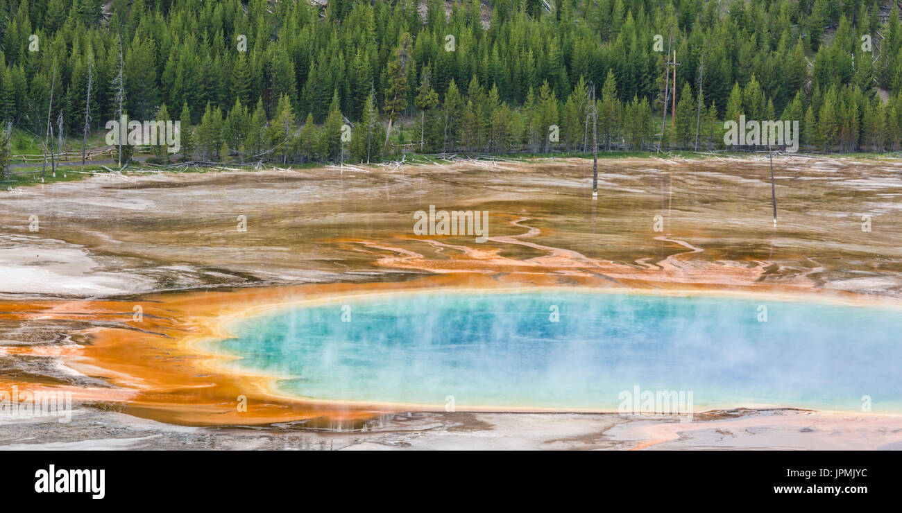 Tourists line the boardwalk at the Grand Prismatic Spring in Midway Geyser Basin, seen from above in Yellowstone National Park, Wyoming. - Stock Image
